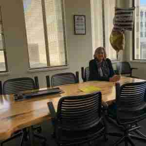 Barbara Mock cleaning out her desk for retirement